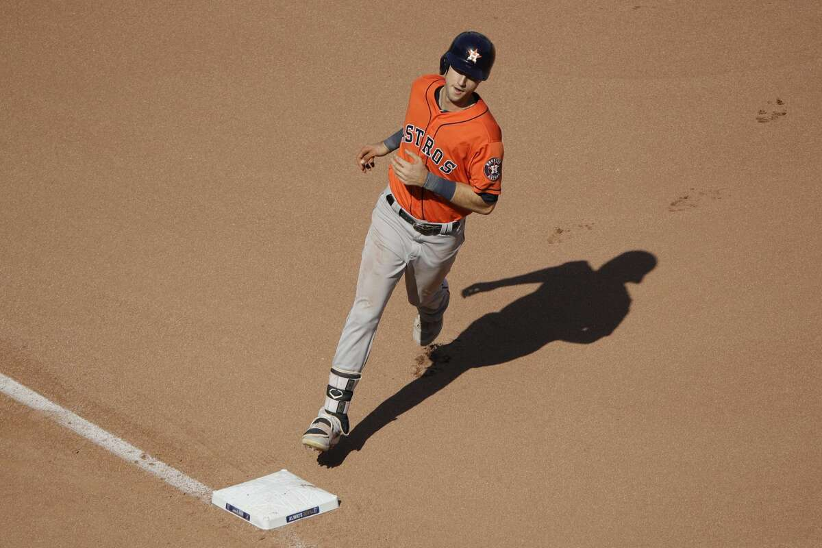 Houston Astros' Kyle Tucker rounds the bases after hitting a two-run home run during the eighth inning of a baseball game against the Kansas City Royals Sunday, Sept. 15, 2019, in Kansas City, Mo. (AP Photo/Charlie Riedel)