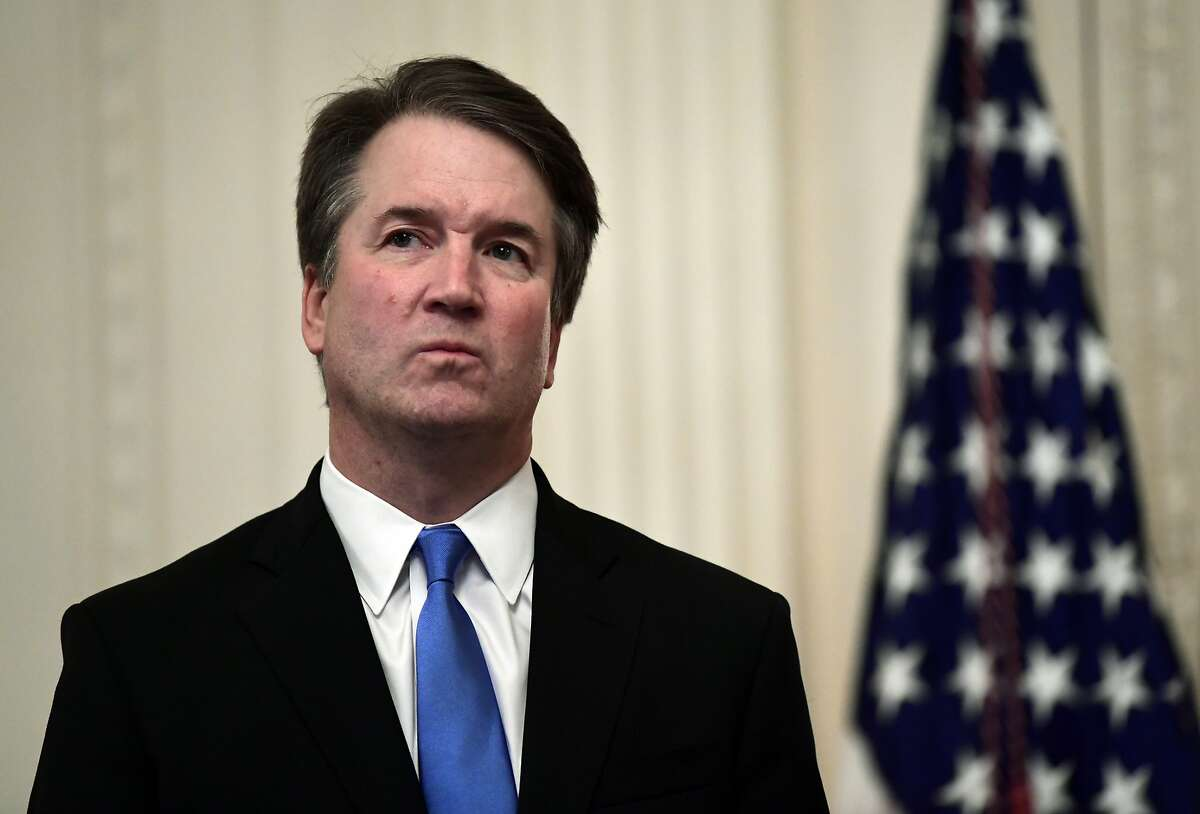 In this Oct. 8, 2018, file photo, Supreme Court Justice Brett Kavanaugh stands before a ceremonial swearing-in in the East Room of the White House in Washington. At least two Democratic presidential candidates, Kamala Harris and Kamala Harris are calling for the impeachment of Supreme Court Justice Brett Kavanaugh in the face of a new, uninvestigated, allegation of sexual impropriety when he was in college.