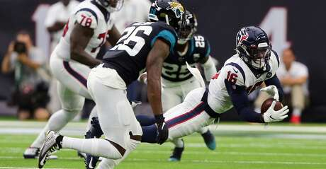HOUSTON, TEXAS - SEPTEMBER 15: Keke Coutee #16 of the Houston Texans makes a catch in front of Jarrod Wilson #26 of the Jacksonville Jaguars first quarter at NRG Stadium on September 15, 2019 in Houston, Texas. (Photo by Bob Levey/Getty Images)