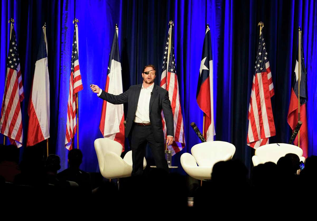 Congressman Dan Crenshaw speaks during his Youth Summit held at the Hyatt Regency Houston, 1200 Louisiana St., Sunday, Sept. 15, 2019, in Houston. The event was for high school and college students.