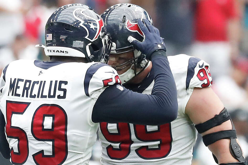 Houston Texans defensive end J.J. Watt (99) and Whitney Mercilus (59) celebrate stopping Jacksonville Jaguars during the second half of an NFL game at NRG Stadium, Sunday, Sept. 15, 2019, in Houston.