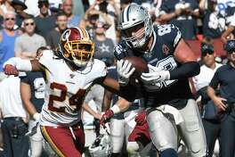 Dallas tight end Jason Witten catches the ball in front of Washington cornerback Josh Norman for a first down in the fourth quarter at FedEx Field in Landover, Maryland, on Sunday, Sept. 15, 2019. The Cowboys defeated the Redskins, 31-21.