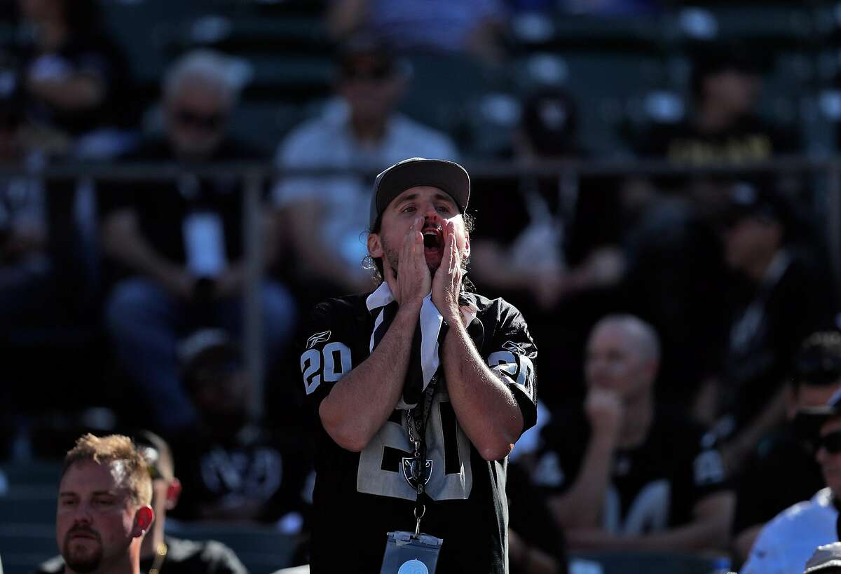 An unhappy fan yells at Jon Gruden In final seconds of the second half as the Oakland Raiders play the Kansas City Chiefs in the coliseum in Oakland, Calif., on Sunday, September 15, 2019.