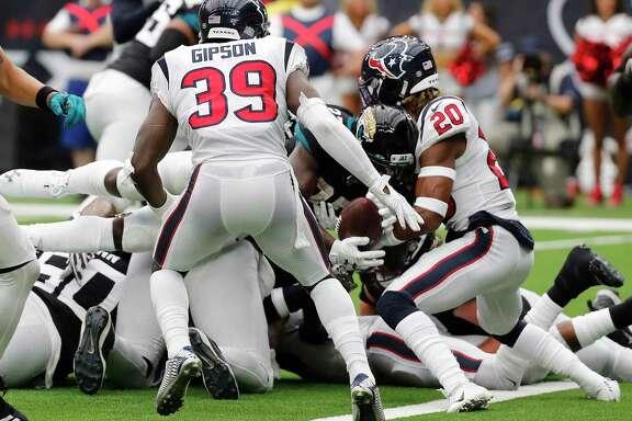 Houston Texans strong safety Justin Reid (20) stops Jacksonville Jaguars running back Leonard Fournette (27) short of the goal line on a 21-point conversion try during an NFL football game at NRG Stadium on Sunday, Sept. 15, 2019, in Houston.