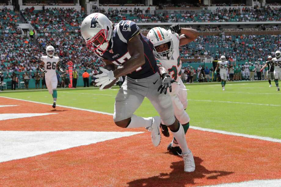 New England Patriots wide receiver Antonio Brown (17) scores a touchdown as Miami Dolphins cornerback Jomal Wiltz (33) attempts to defend, during the first half at an NFL football game, Sunday, Sept. 15, 2019, in Miami Gardens, Fla. (AP Photo/Lynne Sladky) Photo: Lynne Sladky / Copyright 2019 The Associated Press. All rights reserved.