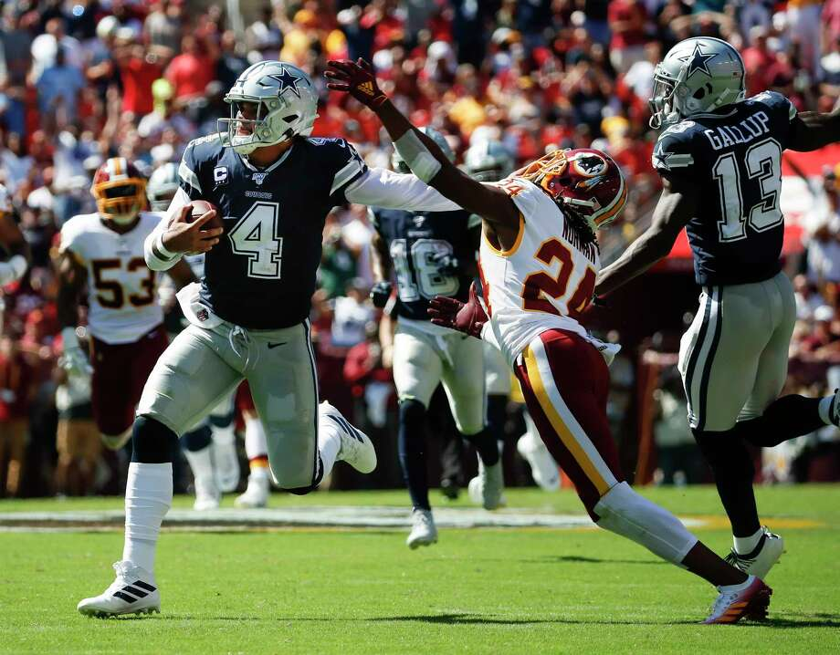 Dallas Cowboys quarterback Dak Prescott (4) breaks away from Washington Redskins cornerback Josh Norman (24) to run downfield in the first half of an NFL football game, Sunday, Sept. 15, 2019, in Landover, Md. Also on the field is Dallas Cowboys wide receiver Michael Gallup (13). (AP Photo/Alex Brandon) Photo: Alex Brandon / Copyright 2019 The Associated Press. All rights reserved.