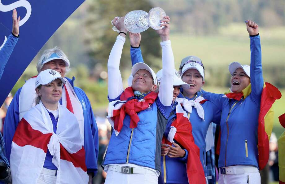 Team Europe's Suzann Pettersen, center, celebrates with her team and the trophy following Team Europe's victory in the Solheim Cup against the US at Gleneagles, Auchterarder, Scotland, Sunday, Sept. 15, 2019. (Ian Rutherford/PA via AP) Photo: Ian Rutherford / PA Wire
