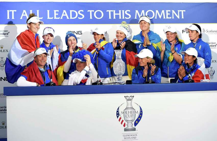 Team Europe's Suzann Pettersen, bottom left, announces her retirement in the post match press conference following Team Europe's victory in the Solheim Cup against the US at Gleneagles, Auchterarder, Scotland, Sunday, Sept. 15, 2019. (Ian Rutherford/PA via AP)
