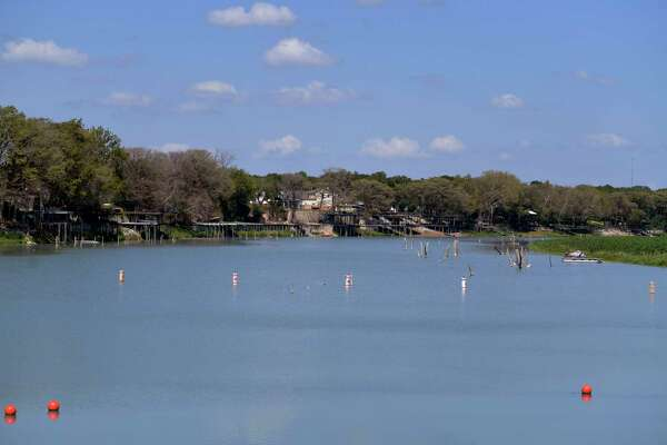 Lake McQueeney, formed in 1928, is a popular recreation spot on the Guadalupe River with many homes and businesses having been built around it. The Guadalupe-Blanco River Authority wants to drain it, saying the spill gates on the dam there and at three of its remaining lakes could fail at any time, posing a risk to people on the lake and on the shore.