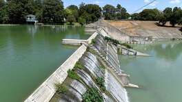 The dam at Lake McQueeney, shown here, and at five other lakes on the Guadalupe River were built in the late 1920s and early 1930s by private developers to generate electricity. On two of the dams, spill gates have failed. The Guadalupe-Blanco River Authority says the dams no longer make enough money as hydroelectric power generators. It wants to drain the lakes because it has deemed the dams unsafe.
