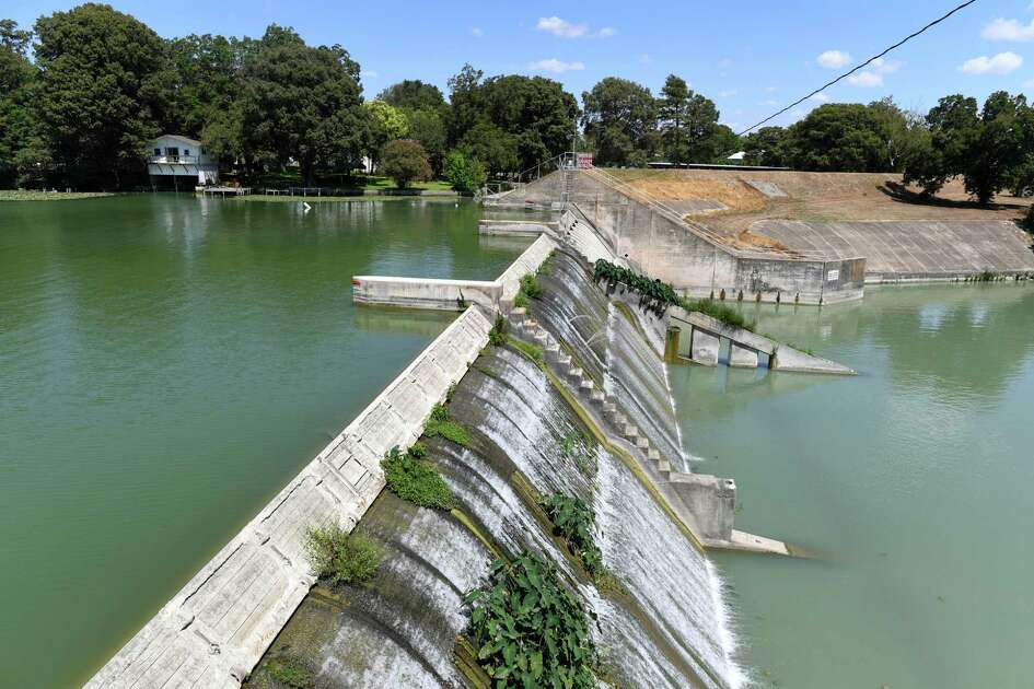 The dam at Lake McQueeney, shown here, and at five other lakes on the Guadalupe River were built in the late 1920s and early 1930s by private developers to generate electricity. The Guadalupe-Blanco River Authority says the dams are antiquated and no longer make money as hydroelectric power generators.