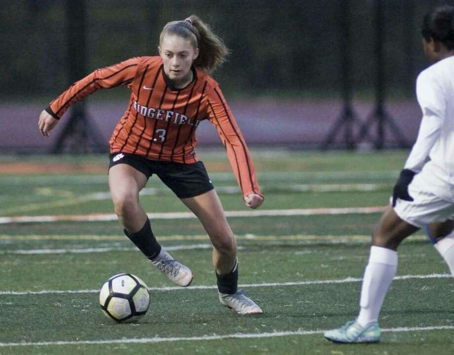 Carolyn Donovan (shown in a state tournament game last year) was part of a Ridgefield defense that shut out Greenwich in the season opener. Photo: Scott Mullin / For Hearst Connecticut Media