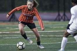 Carolyn Donovan (shown in a state tournament game last year) was part of a Ridgefield defense that shut out Greenwich in the season opener.