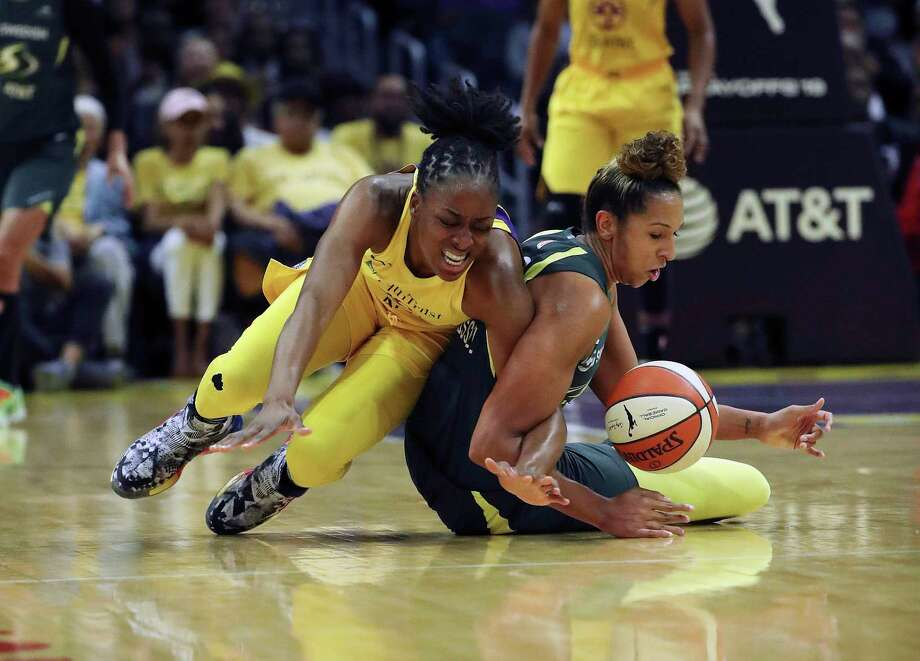 Los Angeles Sparks forward Nneka Ogwumike and Seattle Storm forward Natasha Howard (6) battle for a loose ball in the first half of the second round of the WNBA basketball playoffs Sunday, Sept. 15, 2019 in Los Angeles. (Gina Ferazzi/Los Angeles Times via AP) Photo: Gina Ferazzi / Los Angeles Times