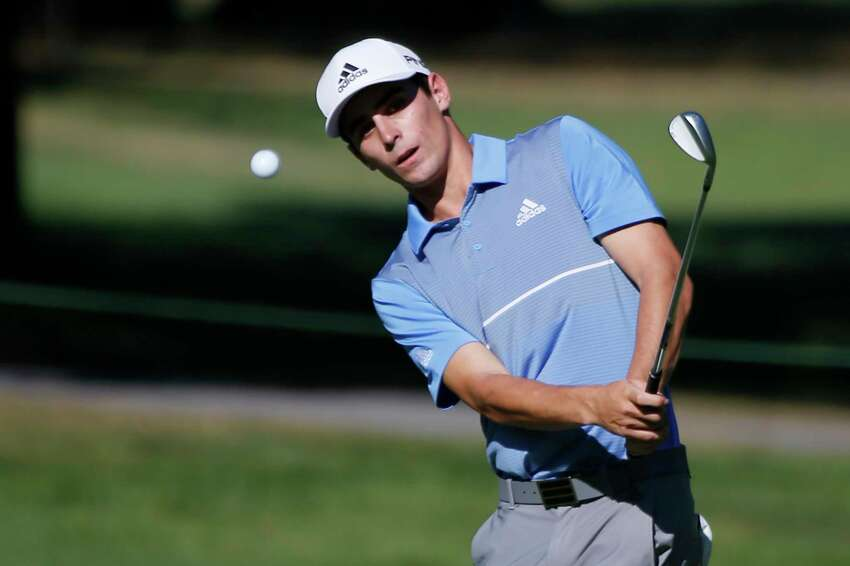 Joaquin Niemann, of Chile, hits up to thew 11th green during the A Military Tribute at The Greenbrier golf tournament in White Sulphur Springs, W.Va., Sunday, Sept. 15, 2019. Niemann won the tournament. (AP Photo/Steve Helber)