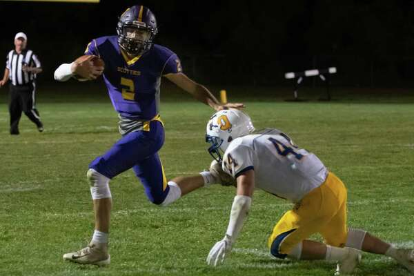 Ballston Spa quarterback Keegan Zoller breaks a tackle from Queensbury linebacker James Ward during their first game of the season on Friday, Sept. 6, 2019, in Ballston Spa, N.Y. (Jenn March, Special to the Times Union )
