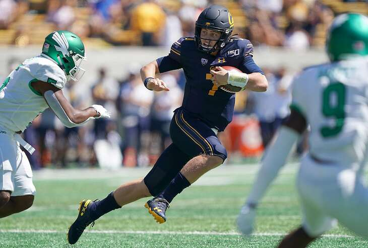 BERKELEY, CA - SEPTEMBER 14: Chase Garbers #7 of the California Golden Bears scrambles with the ball against the North Texas Mean Green during the first quarter of an NCAA football game at California Memorial Stadium on September 14, 2019 in Berkeley, California. (Photo by Thearon W. Henderson/Getty Images)
