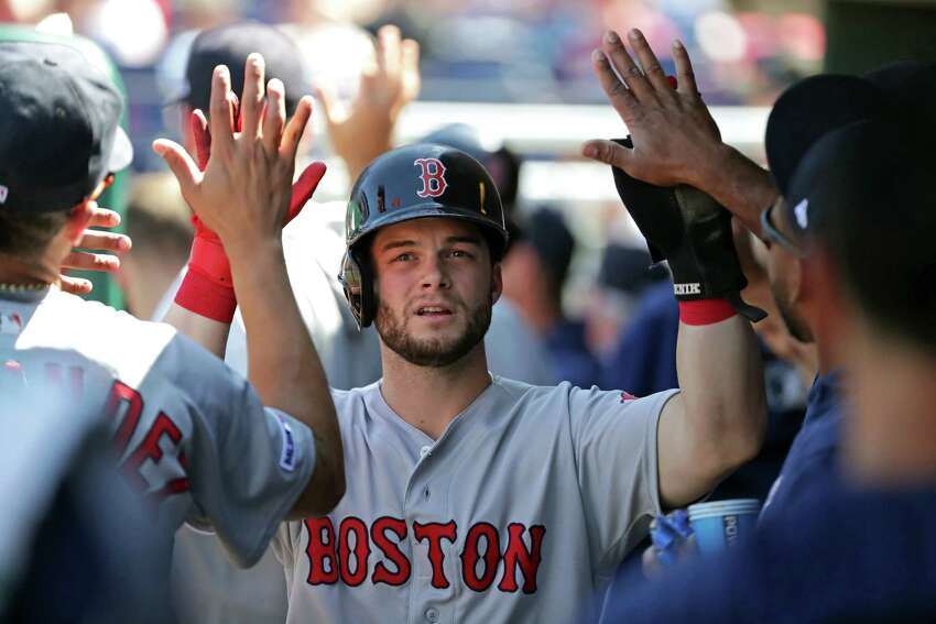 PHILADELPHIA, PA - SEPTEMBER 15: Andrew Benintendi #16 of the Boston Red Sox high-fives teammates in the dugout after scoring in the first inning during a game against the Philadelphia Phillies at Citizens Bank Park on September 15, 2019 in Philadelphia, Pennsylvania. (Photo by Hunter Martin/Getty Images)