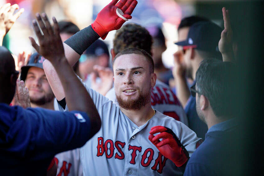 Boston Red Sox's Christian Vazquez is cheered in the dugout after hitting a grand slam during the third inning of a baseball game against the Philadelphia Phillies, Sunday, Sept. 15, 2019, in Philadelphia. (AP Photo/Laurence Kesterson)