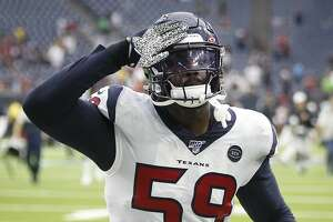 Houston Texans outside linebacker Whitney Mercilus (59) salutes the fans as he runs off the field after the Texans beat the Jacksonville Jaguars 13-12 in an NFL football game at NRG Stadium on Sunday, monthnameap} 15, 2019, in Houston.