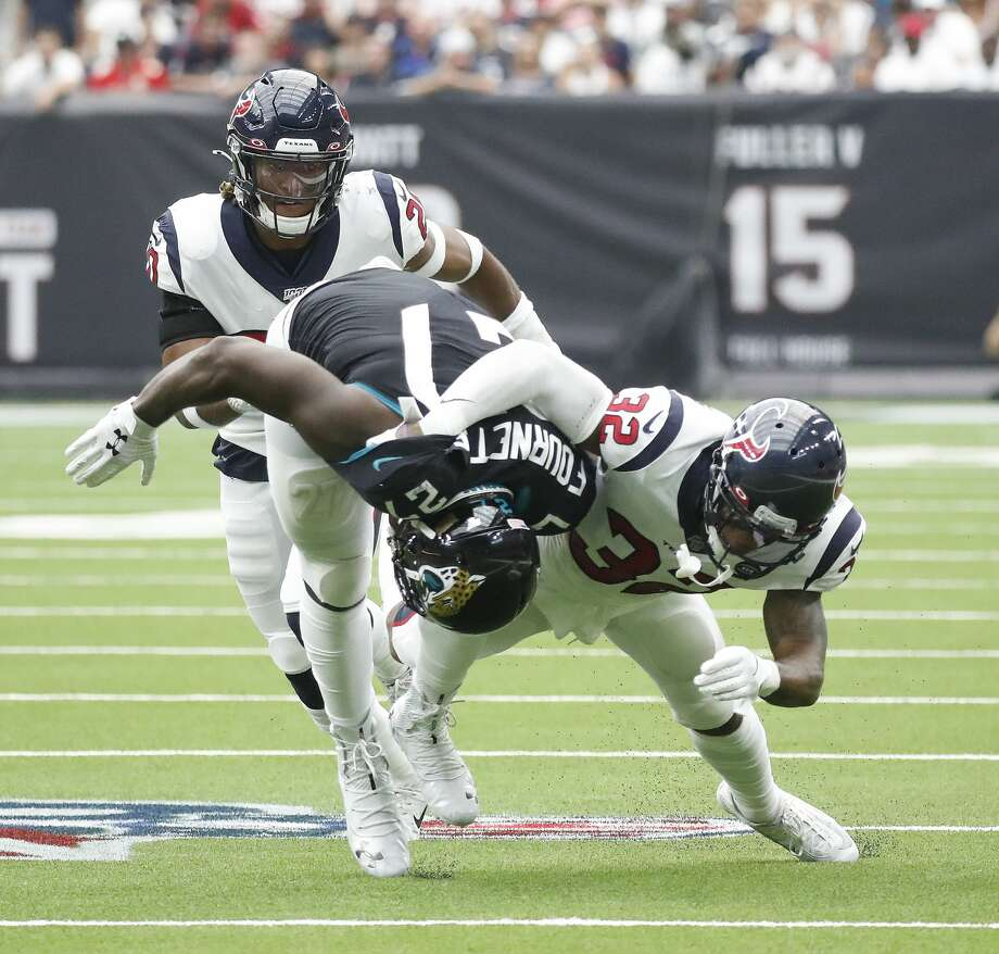 Jacksonville Jaguars running back Leonard Fournette (27) is brought down by Houston Texans cornerback Lonnie Johnson (32) during the second half of an NFL game at NRG Stadium, Sunday, Sept. 15, 2019, in Houston. Photo: Karen Warren/Staff Photographer