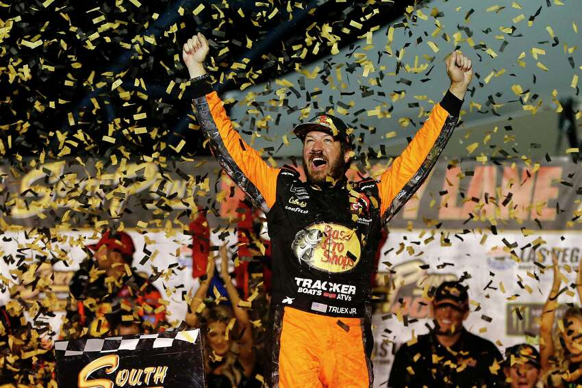LAS VEGAS, NEVADA - SEPTEMBER 15: Martin Truex Jr., driver of the #19 Bass Pro Shops Toyota, celebrates in victory lane after winning the Monster Energy NASCAR Cup Series South Point 400 at Las Vegas Motor Speedway on September 15, 2019 in Las Vegas, Nevada. (Photo by Jonathan Ferrey/Getty Images)