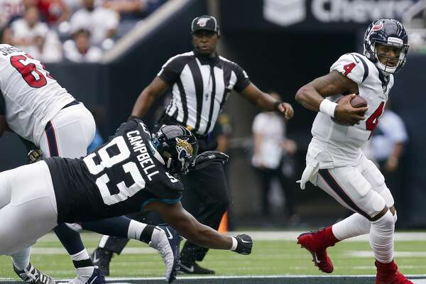Houston Texans quarterback Deshaun Watson (4) avoids the pressure by Jacksonville Jaguars defensive end Calais Campbell (93) during the second quarter of an NFL game at NRG Stadium Sunday, Sept. 15, 2019, in Houston. The Texans won 13-12.