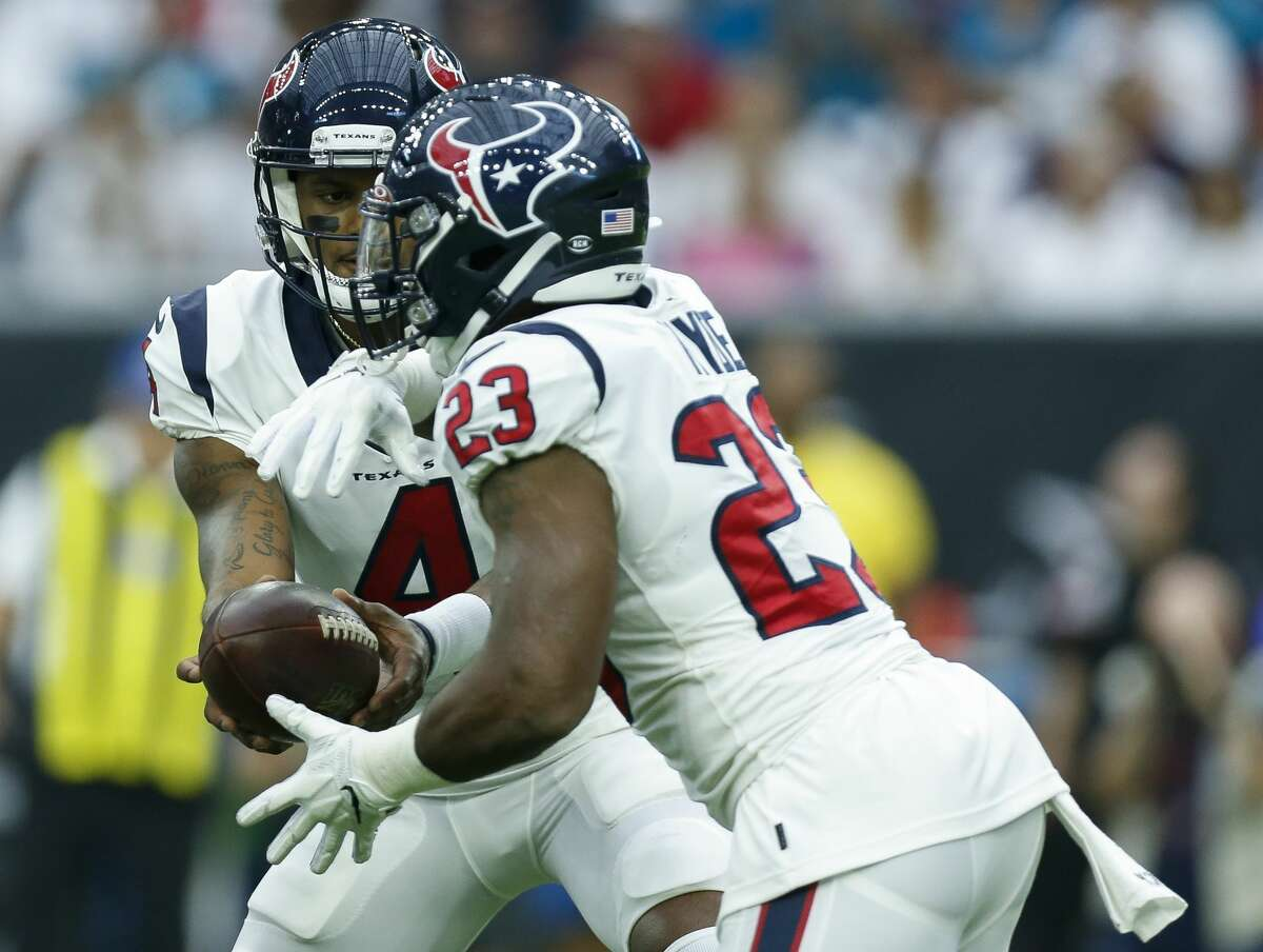 Houston Texans quarterback Deshaun Watson (4) hands-off the ball to running back Carlos Hyde (23) during the first quarter of an NFL game against the Jacksonville Jaguars at NRG Stadium Sunday, Sept. 15, 2019, in Houston. The Texans won 13-12.