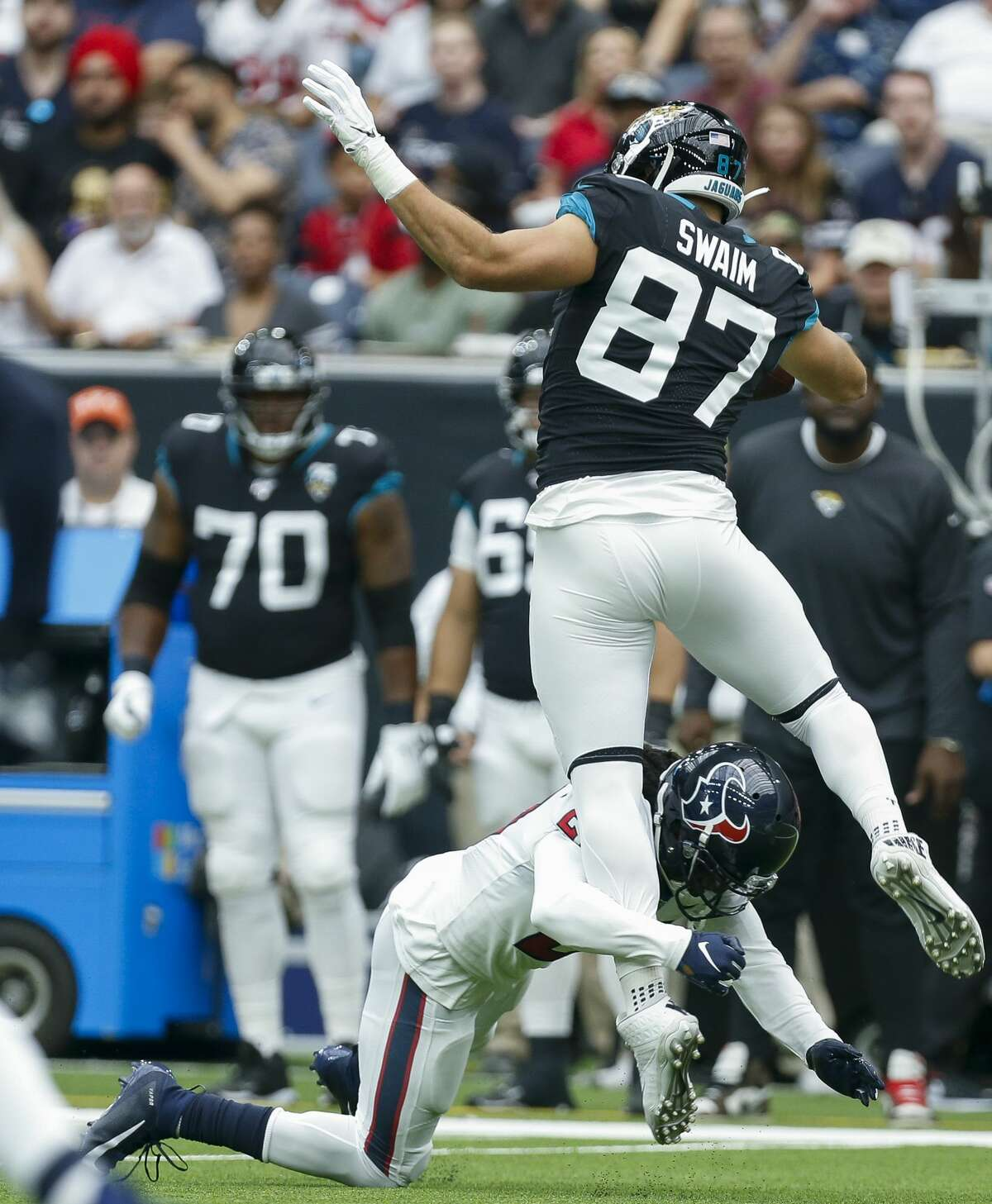 Houston Texans cornerback Bradley Roby (21) tackles Jacksonville Jaguars tight end Geoff Swaim (87) short of a first down during the second quarter of an NFL game at NRG Stadium Sunday, Sept. 15, 2019, in Houston. The Texans won 13-12.