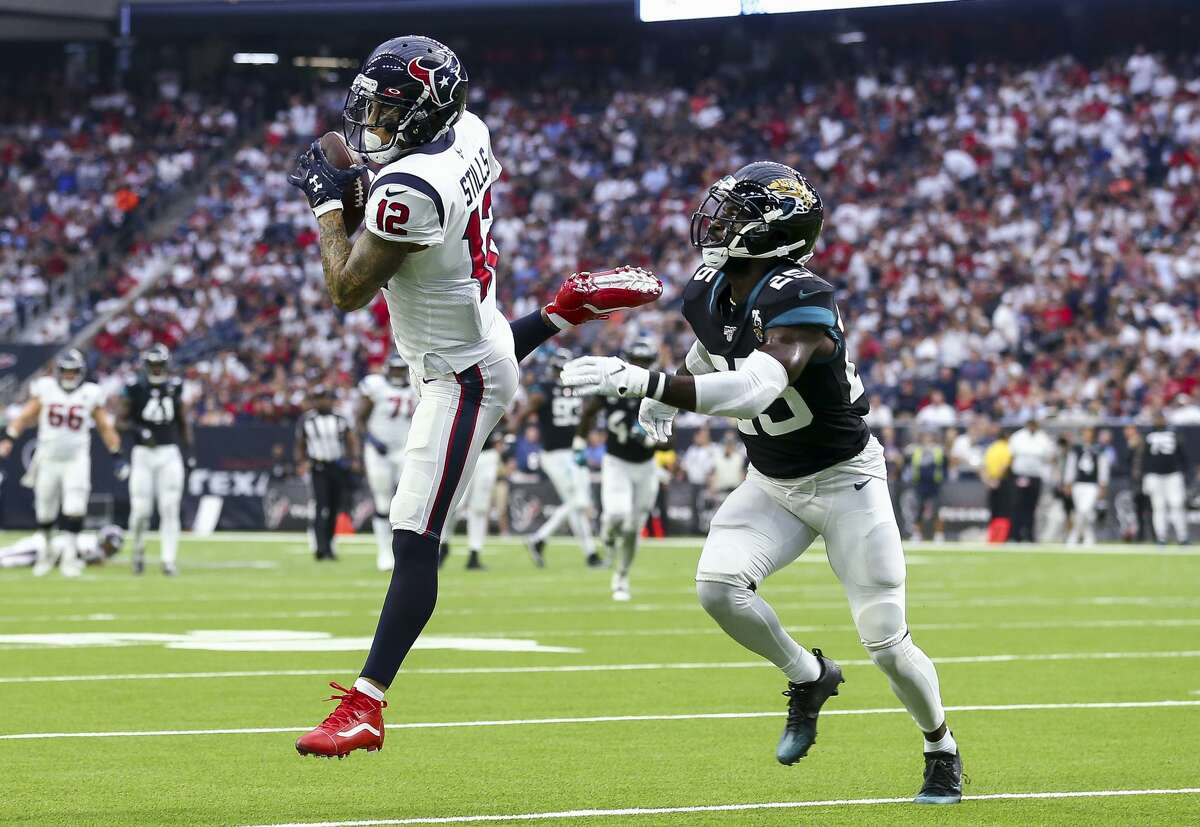 Houston Texans wide receiver Kenny Stills (12) makes a catch against Jacksonville Jaguars defensive back D.J. Hayden (25) during the second quarter of an NFL game at NRG Stadium Sunday, Sept. 15, 2019, in Houston.