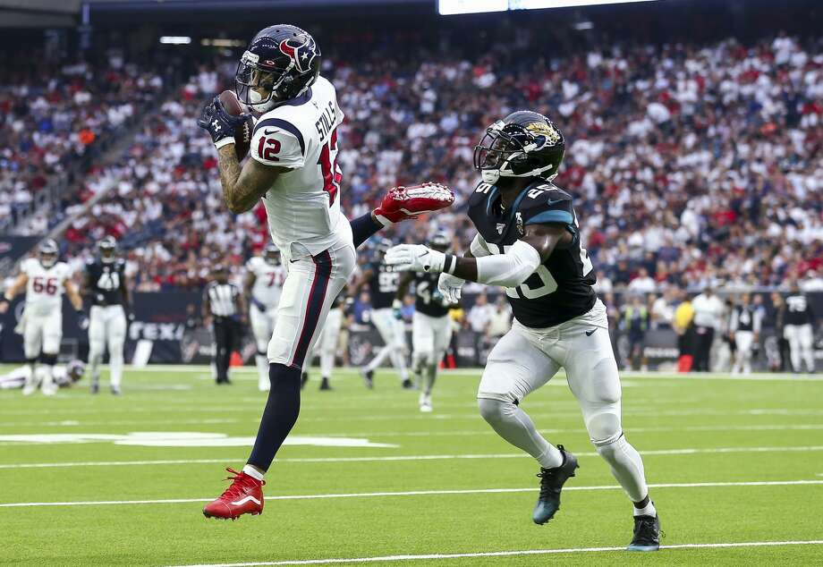 Houston Texans wide receiver Kenny Stills (12) makes a catch against Jacksonville Jaguars defensive back D.J. Hayden (25) during the second quarter of an NFL game at NRG Stadium Sunday, Sept. 15, 2019, in Houston. Photo: Godofredo A Vásquez