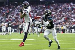 Houston Texans wide receiver Kenny Stills (12) makes a catch against Jacksonville Jaguars defensive back D.J. Hayden (25) during the second quarter of an NFL game at NRG Stadium Sunday, Sept. 15, 2019, in Houston.