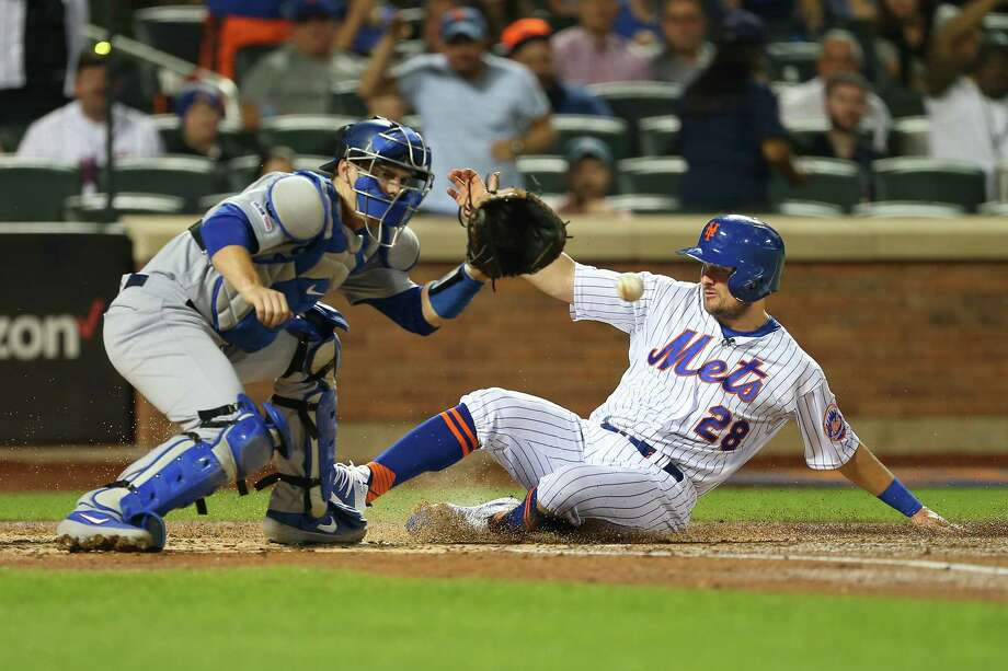 NEW YORK, NY - SEPTEMBER 15: J.D. Davis #28 of the New York Mets scores before the tag of catcher Will Smith #16 of the Los Angeles Dodgers on a two-run triple by Brandon Nimmo #9 during the second inning of a game at Citi Field on September 15, 2019 in New York City. (Photo by Rich Schultz/Getty Images) Photo: Rich Schultz / 2019 Getty Images