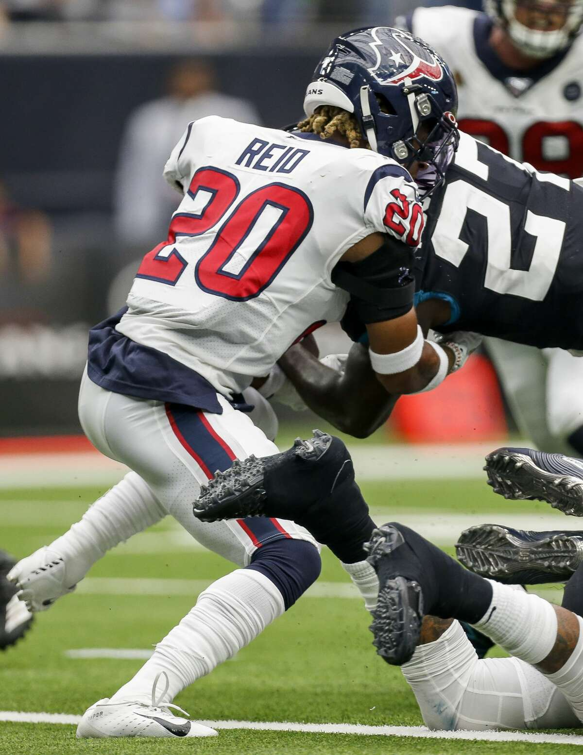 Houston Texans strong safety Justin Reid (20) stops Jacksonville Jaguars running back Leonard Fournette (27) from converting a two-point conversion in the fourth quarter of an NFL game at NRG Stadium Sunday, Sept. 15, 2019, in Houston. The Texans won 13-12.