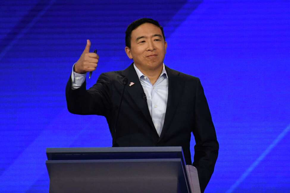 Democratic presidential hopeful Tech entrepreneur Andrew Yang gestures during the third Democratic primary debate of the 2020 presidential campaign season hosted by ABC News in partnership with Univision at Texas Southern University in Houston, Texas on September 12, 2019. (Photo by Robyn BECK / AFP)ROBYN BECK/AFP/Getty Images