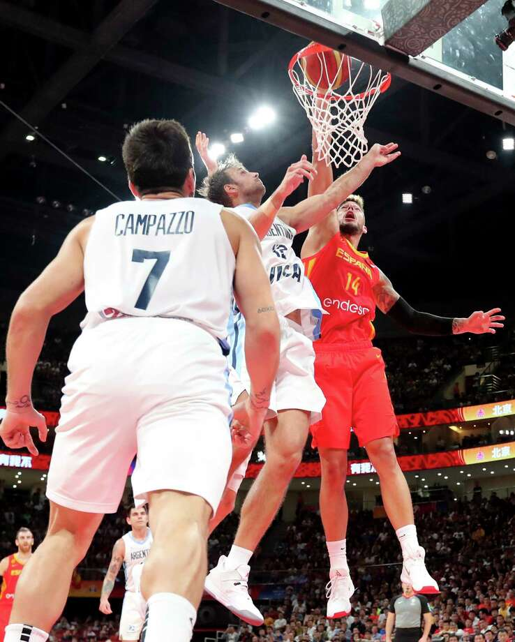 Spain's Willy Hernangomez Geuer, right, tries to dunk near Argentina's Marcos Delia and Facundo Campazzo, left, during the final of the FIBA Basketball World Cup held at the Cadillac Arena in Beijing, Sunday, Sept. 15, 2019. (AP Photo/Ng Han Guan, Pool) Photo: Ng Han Guan / Copyright 2019 The Associated Press. All rights reserved.