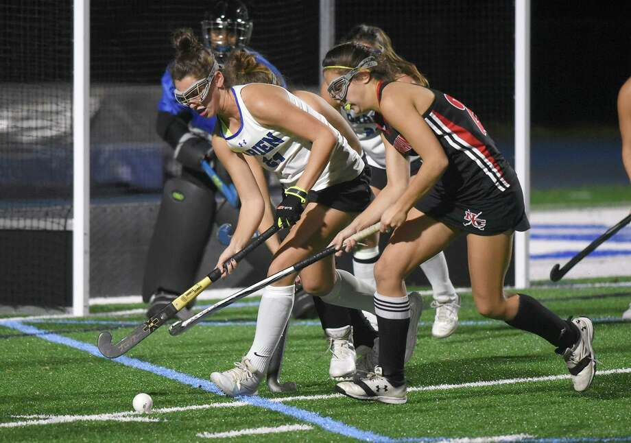 New Canaan's Marlee Smith and Darien's Lindsey Olson battle for the ball during the 2018 CIAC Class L field hockey playoffs at Darien High School. Photo: Dave Stewart / Hearst Connecticut Media / Hearst Connecticut Media