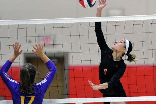 New Canaan's Alyssa Lee puts a shot back over the net during a volleyball match against Westhill at New Canaan High School on Sept. 18, 2018.