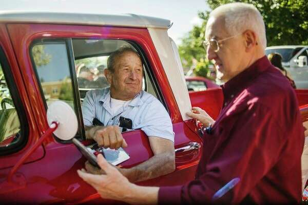 Catching up at the car show Midland residents Herb Michels, left, and Ron Gillespie, right, chat before Michels drives his Chevrolet Apache 10 in the Cruise 'N Car Show Saturday evening in downtown Midland. For more photos, go to www.ourmidland.com. (Katy Kildee/kkildee@mdn.net)