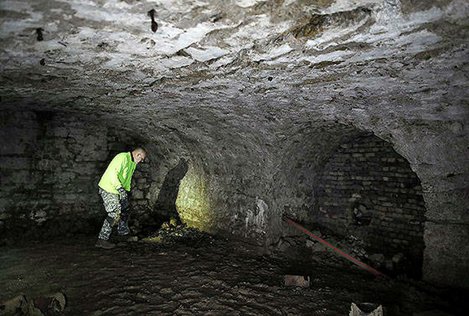 Robert Bier, an amateur historian, sifts through items along the floor of a beer cellar he discovered under the ground in Janesville, Wisconsin. It's the site of several breweries that were built on the site, going back to 1856. Photo: Anthony Wahl | Janesville Gazette (AP)