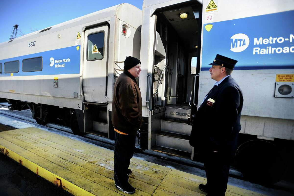 Rider Thomas Dapp, left, prepares to board the 2:40 pm Bridgeport bound train on the Metro North Waterbury branch rail line at the Derby/Shelton station in Derby, Conn. on Tuesday, February 14, 2017. The state Department of Transportation is purchasing a fleet of new rail cars to replace its existing push-pull coaches operating on the Hartford Line, Shore Line East, Danbury Line and Waterbury Line. To assist DOT in developing rail cars that are