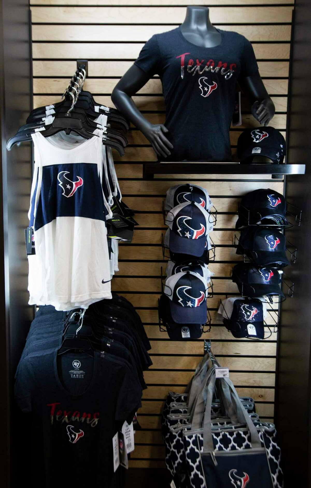 Texan's apparel merchandise display at the new Academy store located in Richmond on Friday, Sept. 13, 2019.