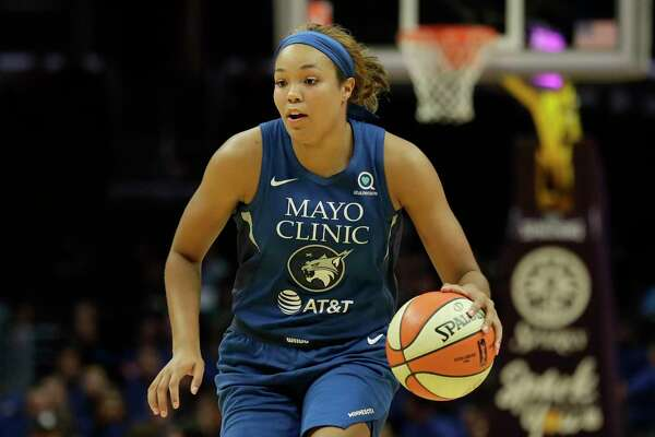 Minnesota Lynx forward Napheesa Collier plays against the Los Angeles Sparks during the first half of an WNBA basketball game in Los Angeles, Tuesday, Aug. 20, 2019.