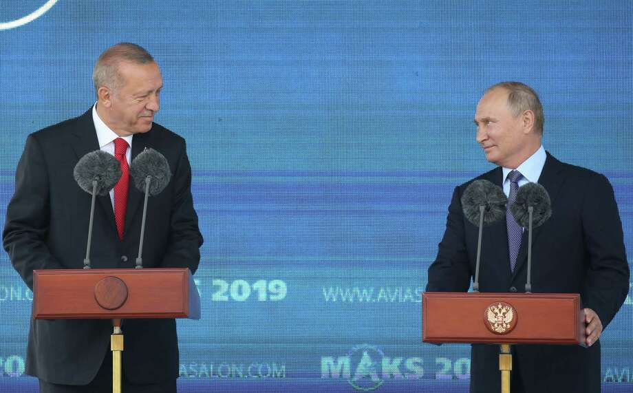 Recep Tayyip Erdogan, Turkey's president (left), and Vladimir Putin, Russia's president, attend a news conference in Moscow on Aug. 27, 2019. Photo: Bloomberg Photo By Andrey Rudakov.77 / © 2019 Bloomberg Finance LP