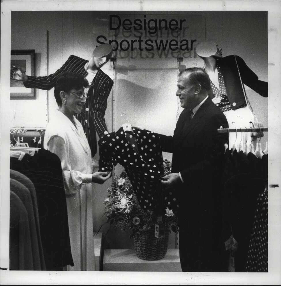 Cohoes, New York - Sandy Schuster, sales associate, and Sanford Zimmerman, owner and chairman of Cohoes, look at a blouse in the designer sportswear department. February 16, 1989 (Paul D. Kniskern Sr./Times Union Archive)