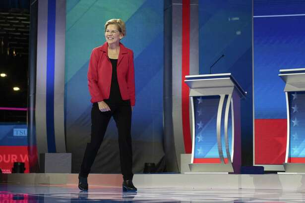 Sen. Elizabeth Warren, D-Mass. and a 2020 presidential candidate, smiles while arriving on stage during the Democratic presidential candidate debate in Houston on Sept. 12, 2019.