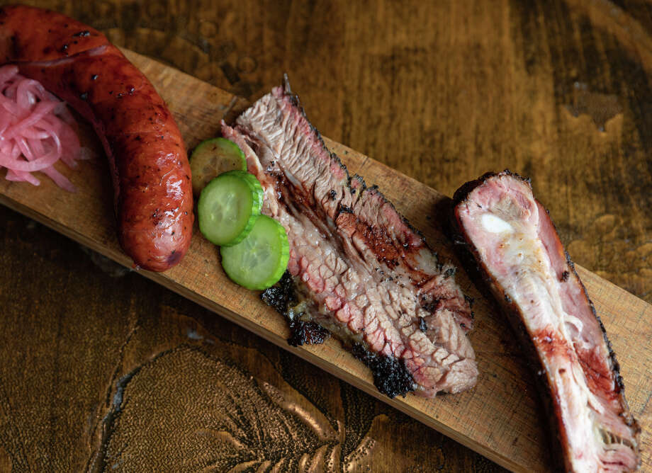 The fifth annual Houston BBQ Throwdown will be held on Sept. 29. Shown: Brisket, smoked sausage, pork ribs and pomegranate reduction from Harlem Road Texas BBQ. Photo: Shawn Chippendale / Shawn Chippendale