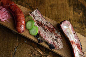 The fifth annual Houston BBQ Throwdown will be held on Sept. 29. Shown: Brisket, smoked sausage, pork ribs and pomegranate reduction from Harlem Road Texas BBQ.