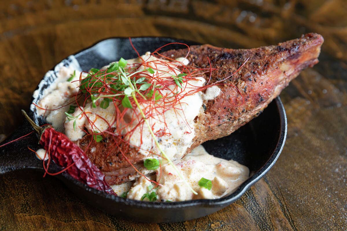 The fifth annual Houston BBQ Throwdown will be held on Sept. 29. Shown: Double-cut Creole pork chop stuffed with boudin and topped with crawfish cream sauce from Victorian's Barbecue.