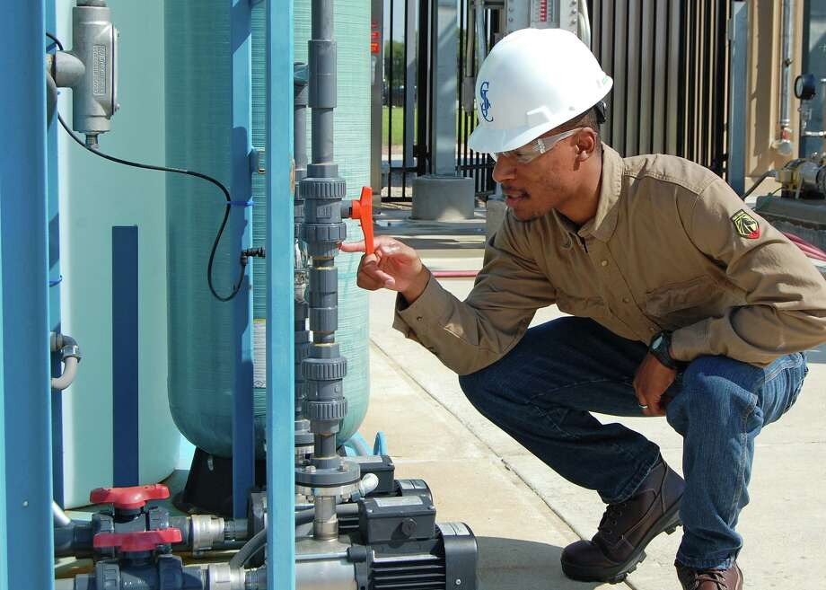 San Jacinto College student Gabriel McKenzie checks a gauge reading on the glycol unit at the new Center for Petrochemical, Energy, and Technology. Photo: Courtesy Of San Jacinto College